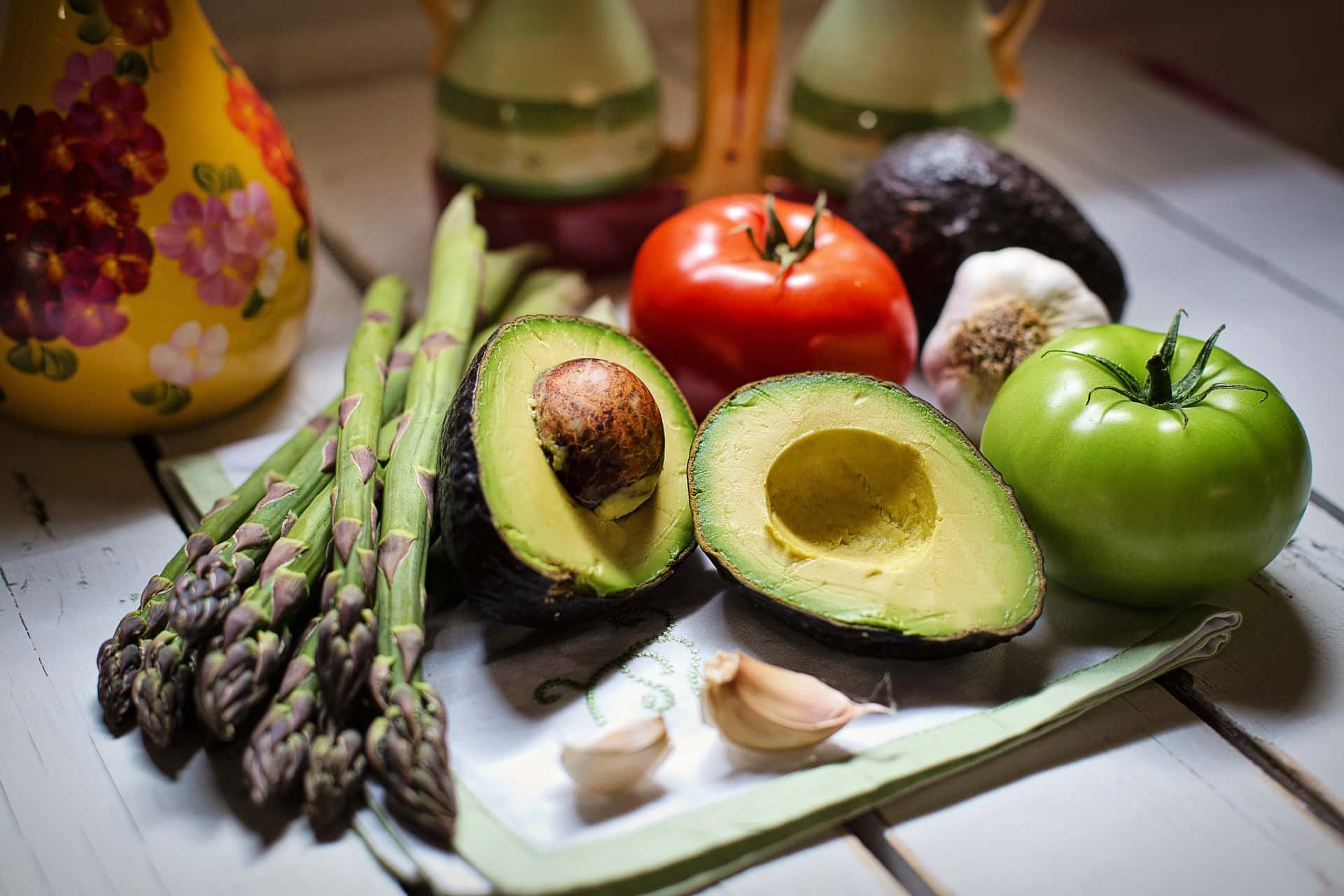 Healthy fresh vegetables: asparagus, avocado, tomato and garlic